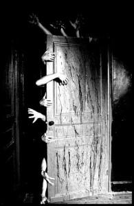 Zombie-arms-horrific-door